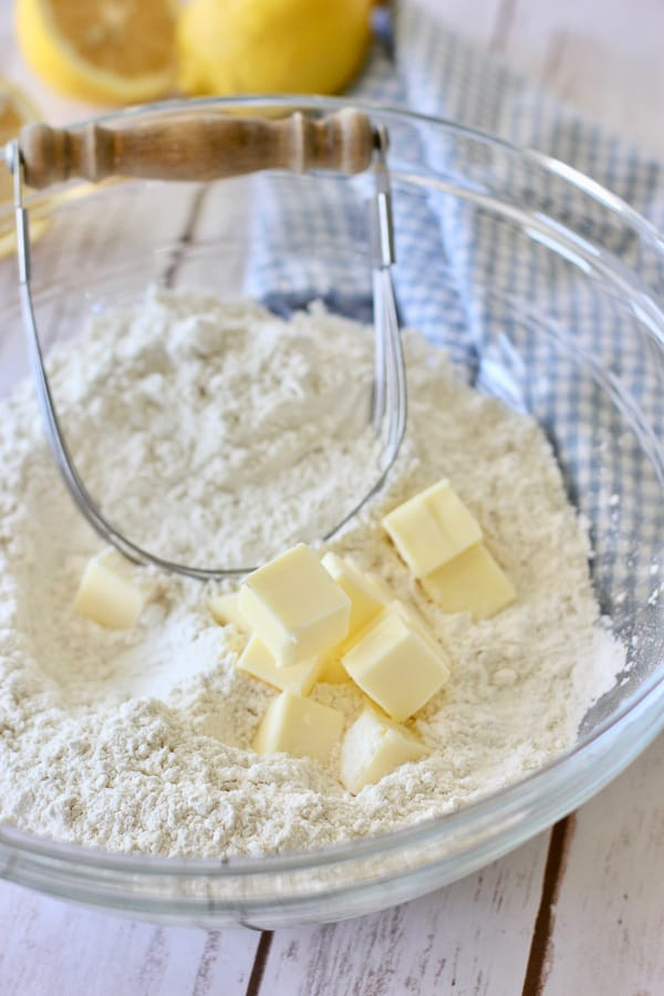 Butter and flour being combined for scones