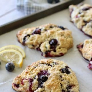 Lemon Blueberry Scones on a baking sheet with parchment