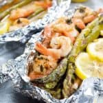 Shrimp and asparagus with lemon in foil pack