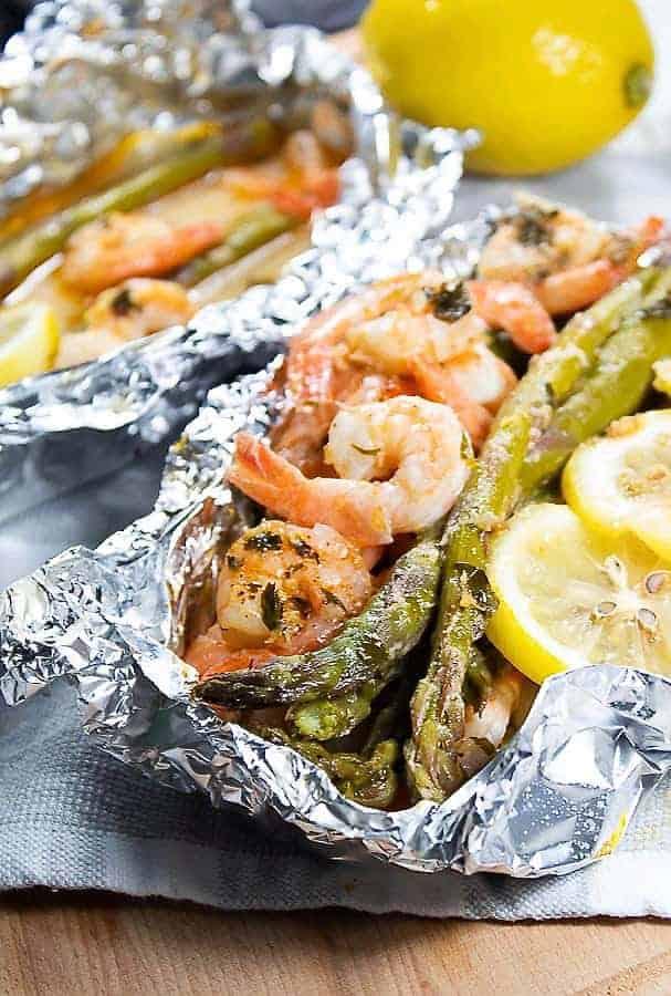 Shrimp and asparagus with lemon in foil pack