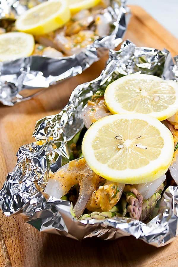 Lemon slices over shrimp in foil packet
