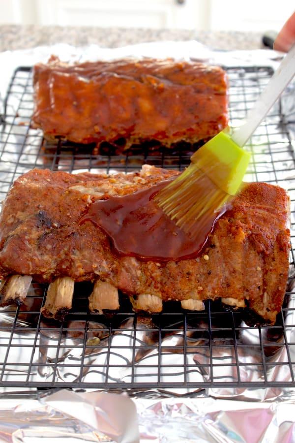 basting ribs with bbq sauce using silicon basting brush