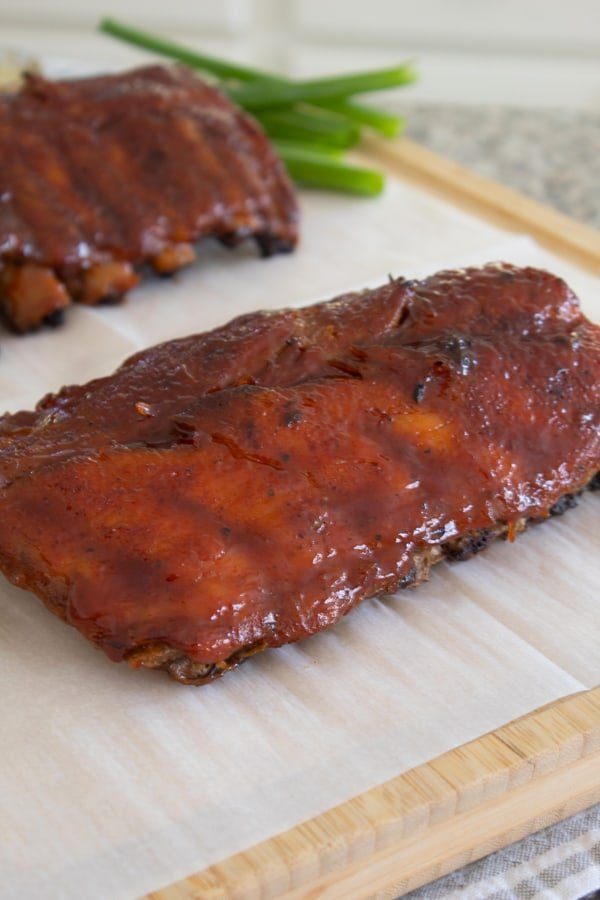 slab of ribs on parchment paper on cutting board
