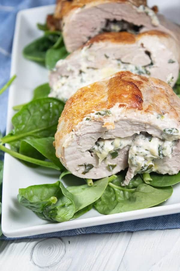 a platter with spinach stuffed pork