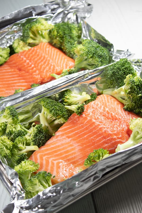 broccoli and salmon on a sheet pan in foil
