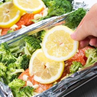 Salmon with lemon garlic and broccoli in foil pouch