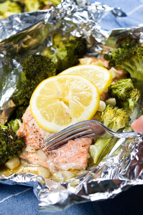 Healthy baked salmon with broccoli on foil