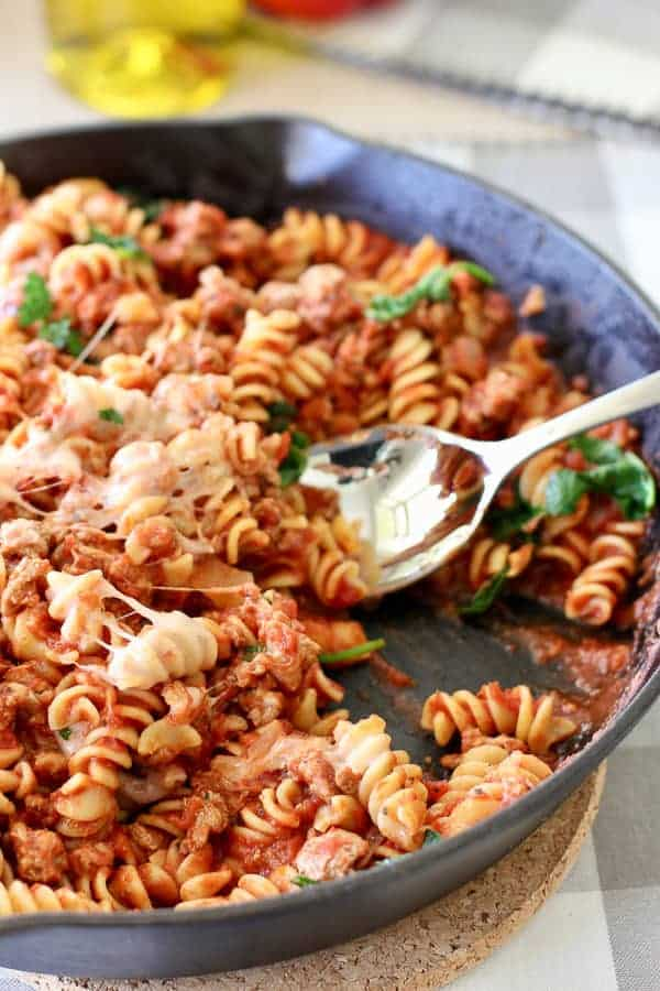 pasta in a cast iron pan being served