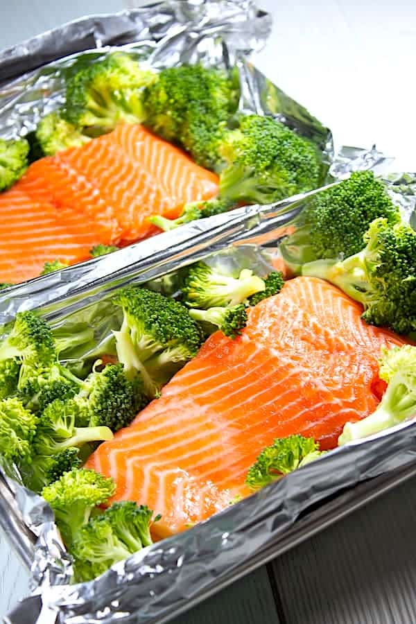 raw salmon and broccoli in foil pouch