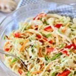 Asian Slaw with Ginger Peanut Dressing in a glass bowl