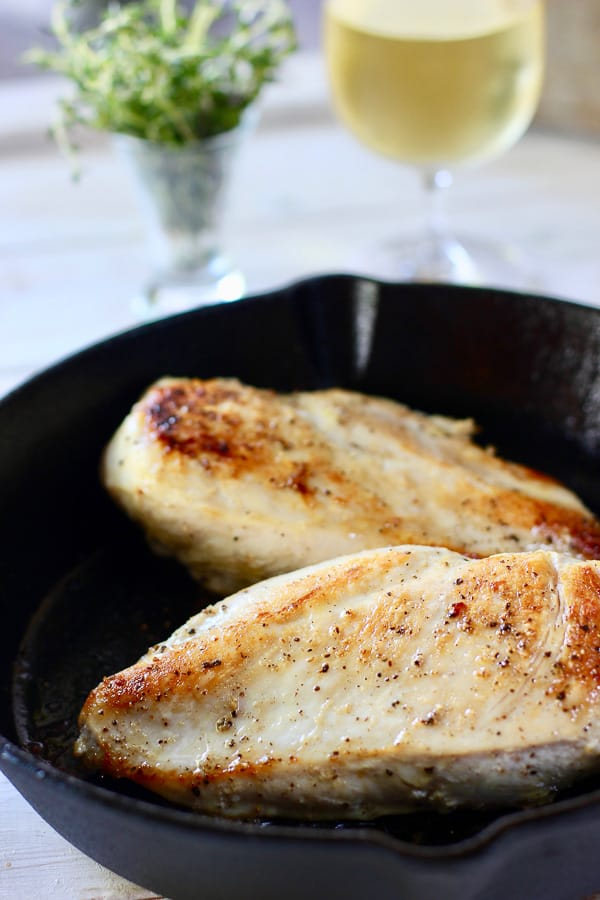 seared chicken breast in cast iron skillet