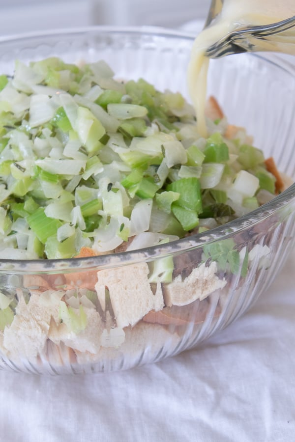 a clear bowl with stuffing mixture being mixed