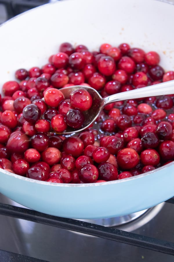 cranberries in a pot on a stove