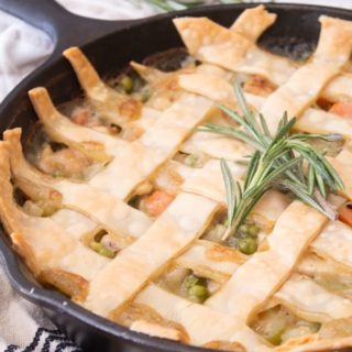 chicken pot pie fresh out of the oven in a black cast iron skillet