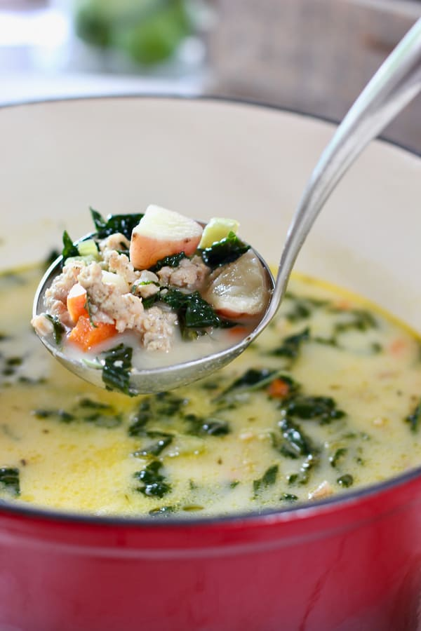 red pot of potato sausage soup
