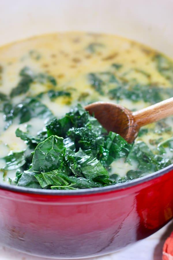 kale into pot of soup