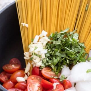 one pot pasta ingredients in a black pot