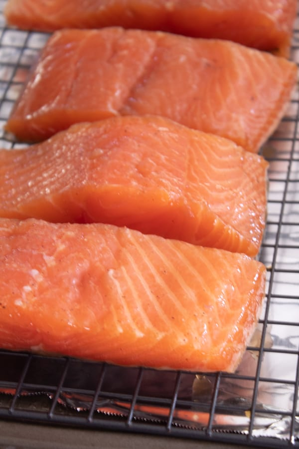 salmon drying after marinating on a wire rack