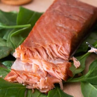 Smoked Salmon on a bed of spinach with a chunk cut out