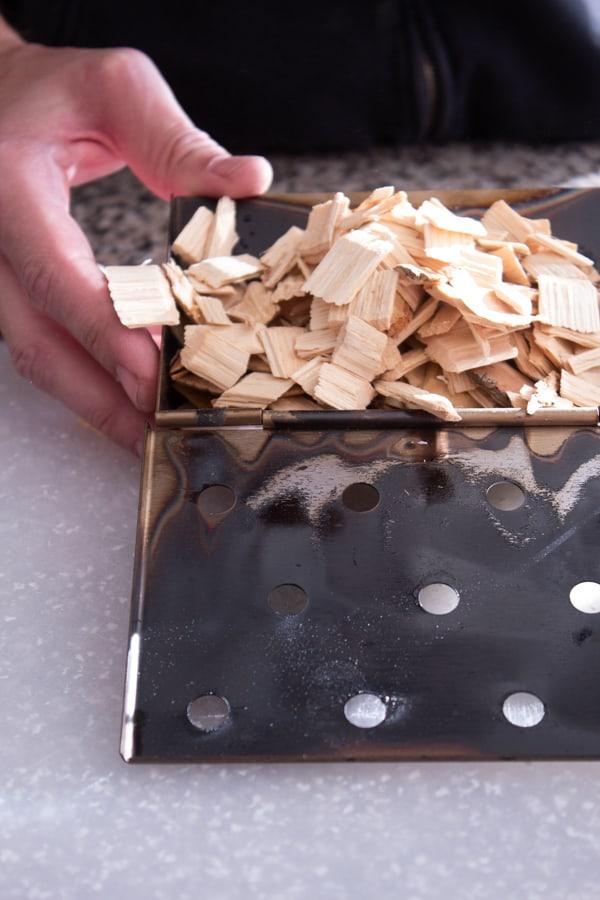 preparing woodchips in smoker box