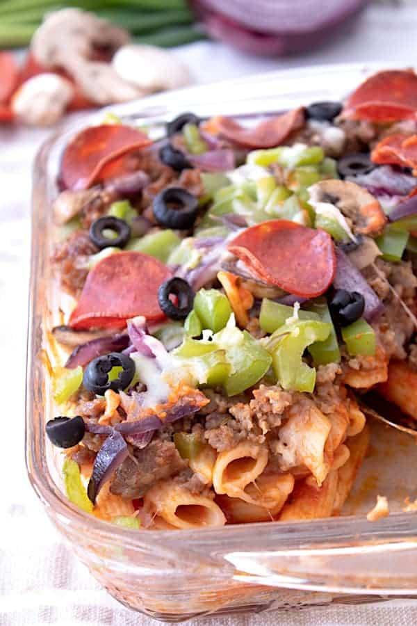 Close up of pizza casserole in a clear casserole dish