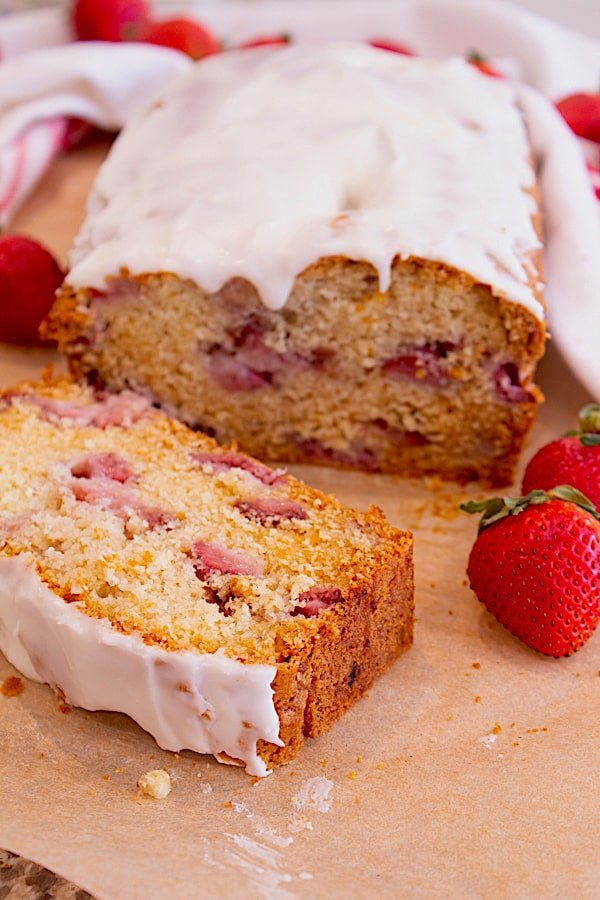 Strawberry Bread Loaf with Icing on parchment paper