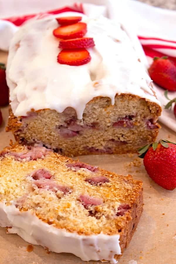 strawberry bread with icing and strawberry slices on top