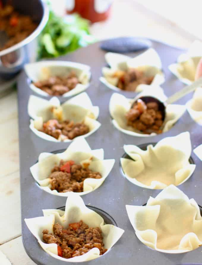 Add ground meat to wonton wrapper