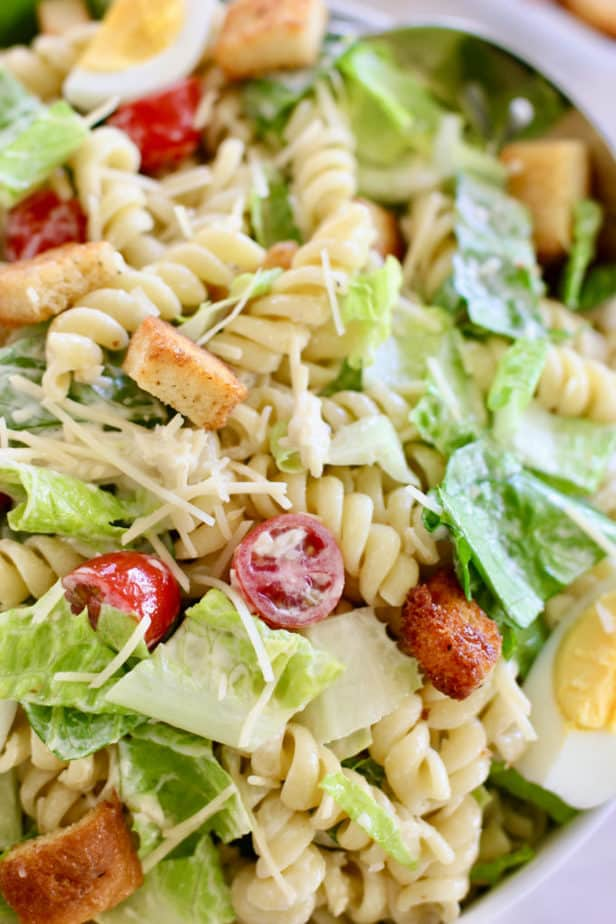 pasta and lettuce combined for a salad