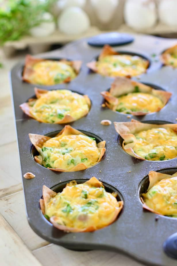 mini quiche in a muffin tin out of the oven