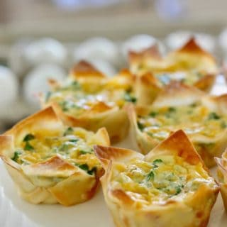 mini quiche in a wonton wrapper on a white platter