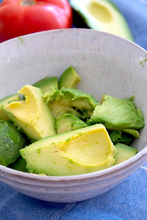 a bowl of ripe avocado chunks