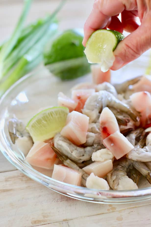 squeeze lime over uncooked fish and shrimp before cooking