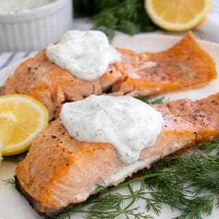 salmon and dill sauce on white platter