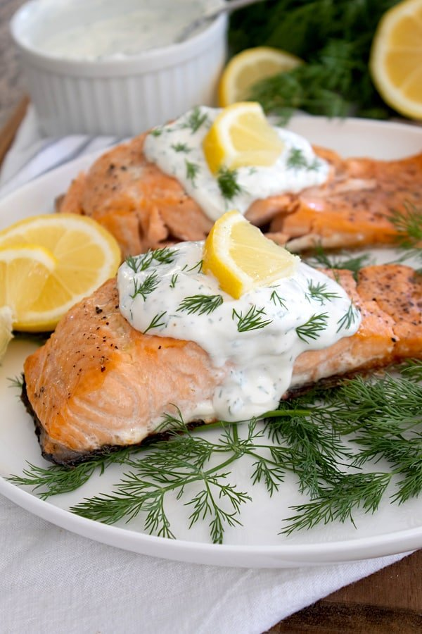 side view of salmon with dill sauce