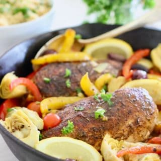 chicken and Mediterranean spices and veggies in a skillet