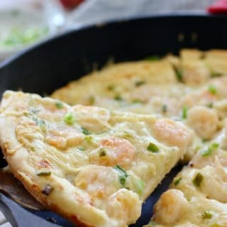 a slice of Shrimp Pizza in a pan