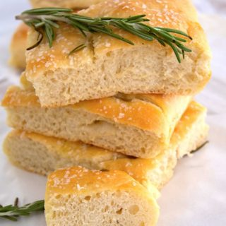 stacked focaccia bread with rosemary sprigs and sea salt