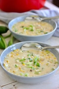 chicken and corn chowder in a gray bowl with spoon