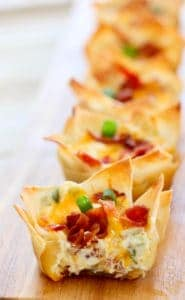Jalapeno Popper Wontons ready to serve on board