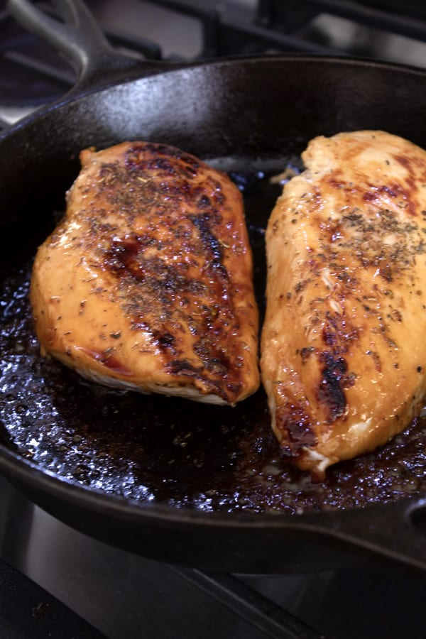 searing chicken in cast iron skillet with honey and butter