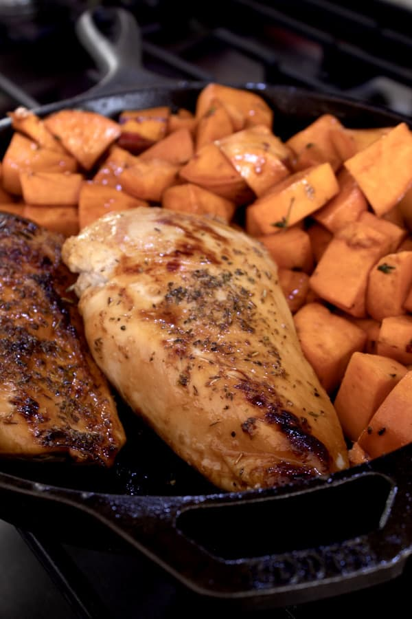 chicken and sweet potatoes before baking in oven
