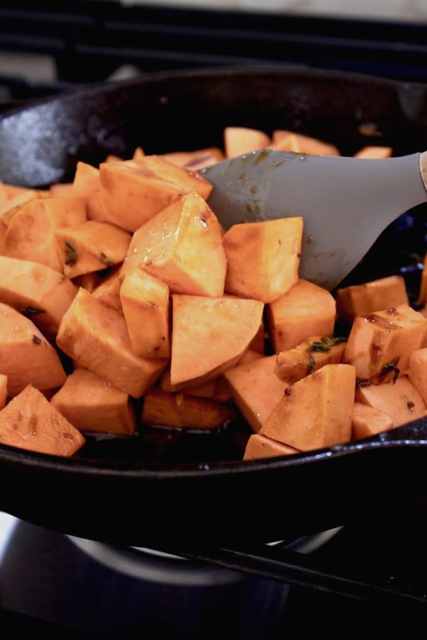 cooking sweet potatoes in skillet