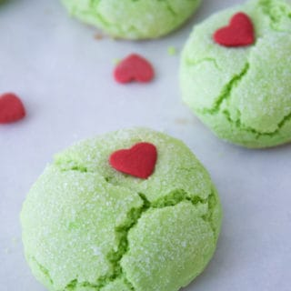 green grinch cookies with heart sprinkles