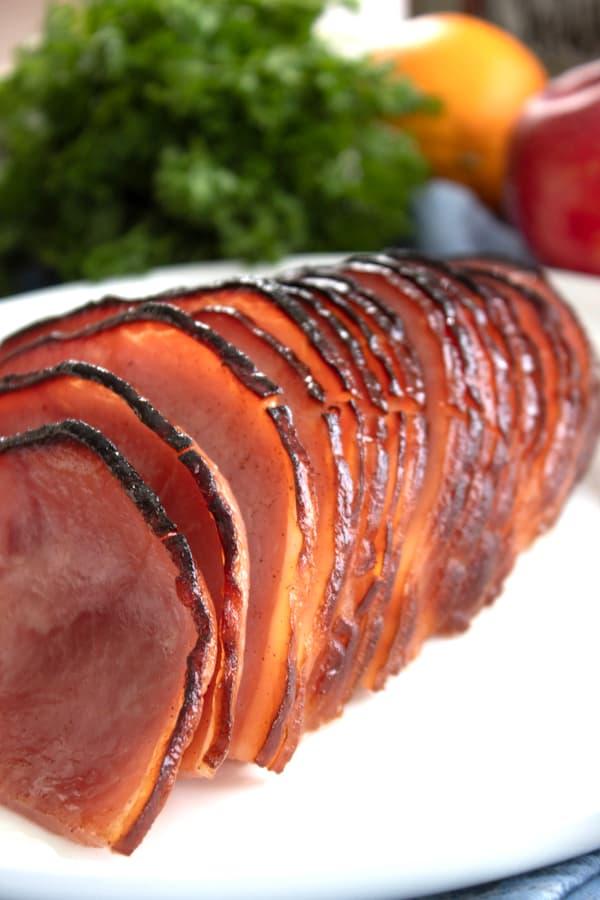 slices of honey baked Ham on a white platter