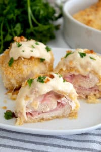 Baked chicken cordon bleu cut in half with dijon sauce on top