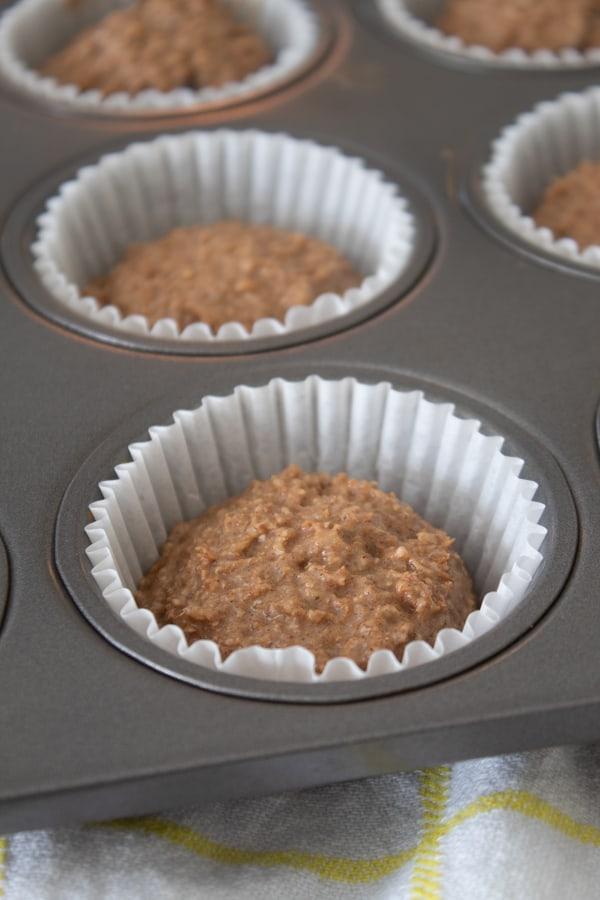 bran muffin batter in muffin tin liners in a muffin tin