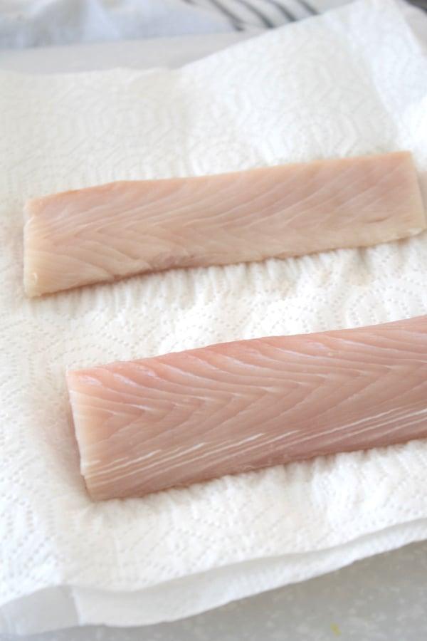 patting mahi mahi dry with paper towel