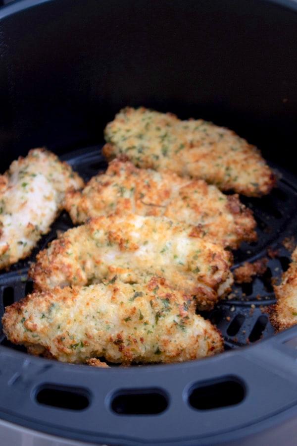 closeup of air fryer chicken tenders in air fryer basket