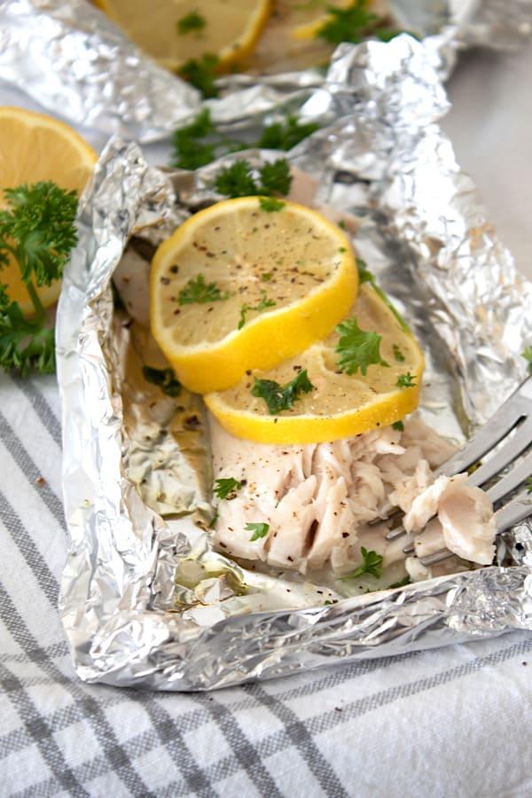 flakey mahi mahi in foil packet with lemon and parsley